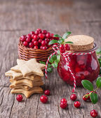 small jar of homemade fresh spicy sweet cranberry sauce with cinnamon