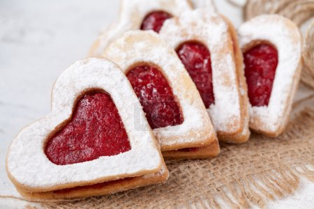 Photo for Heart shaped cookies for valentine's day on textile - Royalty Free Image