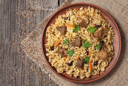 Arabic national rice food called pilaf cooked with fried meat, onion, carrot and garlic
