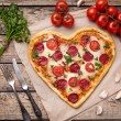 Heart shaped pizza for Valentines day with peppero...