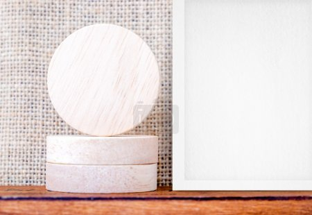 Round wooden pieces and white photo frame