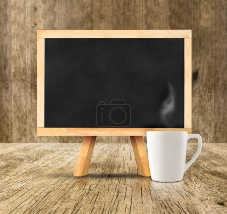 Blackboard with white hot coffee cup