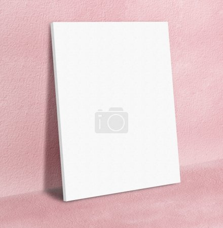 Blank white poster canvas frame leaning at pink concrete paint w