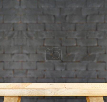 table and blur black brick wall