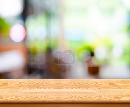 Photo for Empty wood table top with coffee shop blur with bokeh background,Product display template. - Royalty Free Image
