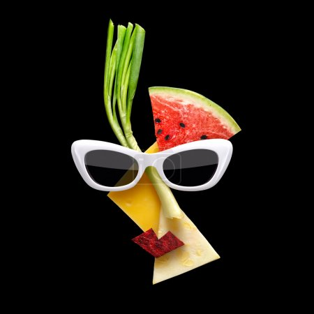 Fruity art. Quirky food concept of cubist style female face in sunglasses made of fresh fruits on black background.