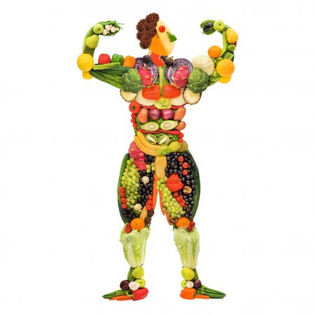 Photo for Fruits and vegetables in the shape of a healthy posing muscular bodybuilder. - Royalty Free Image