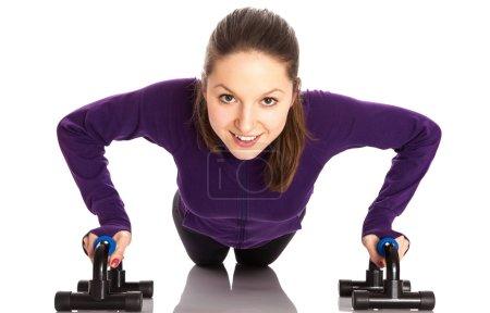 Smiling woman doing push-ups