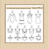 Vector set of hand drawn doodles with lingerie for ladies Illustrations on the theme of fashion Sketches for use in design web site packing textile fabric