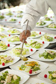 a chef serving salad