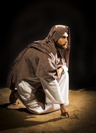 jesus praying on black background