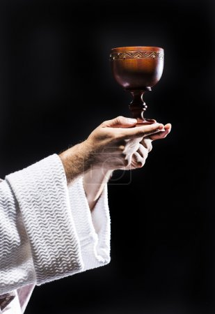 Photo pour Jésus Christ priant Dieu de consacrer le pain et le vin dans la nuit noire - image libre de droit