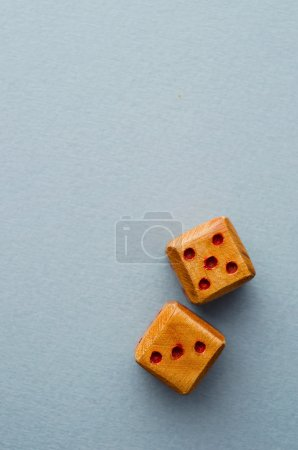 Wooden dices over blue