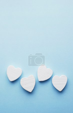 Wooden hearts over blue