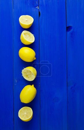 Lemons over blue background