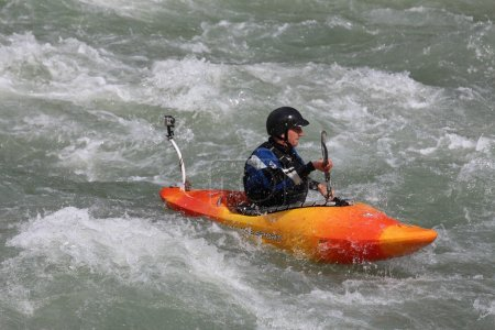 A man is kayaking on the Sjoa river in Norway.