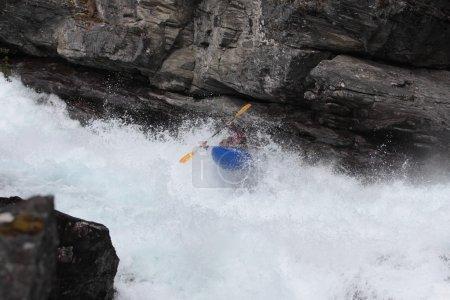 A man in kayak in Norwegian river.