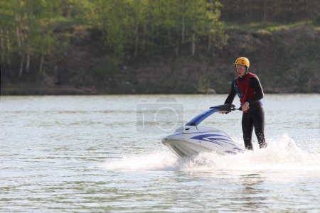 A young man on the jet ski.