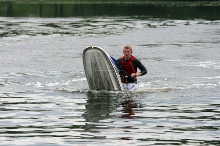 A man fell down from jet ski.