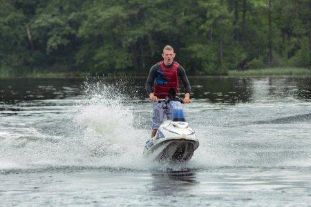 Action Photo Man on jet ski.