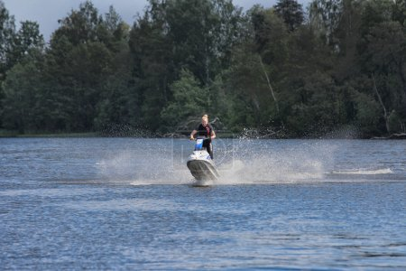 Action Photo young woman on jet ski.