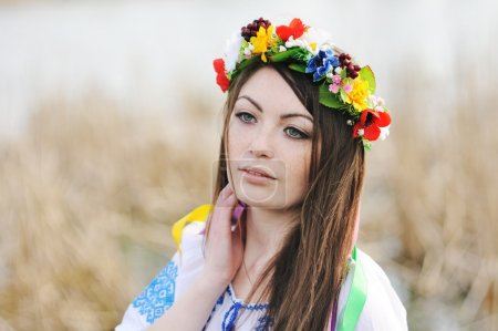 Girl in the Ukrainian national shirt and floral wr...