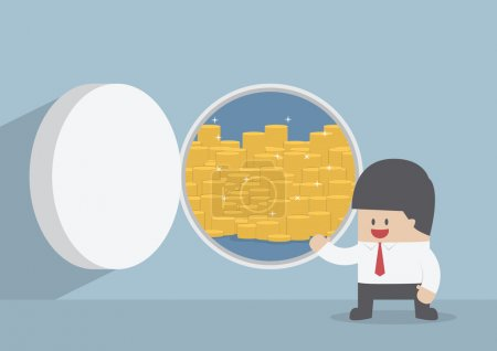 Businessman and opened vault door with gold coins