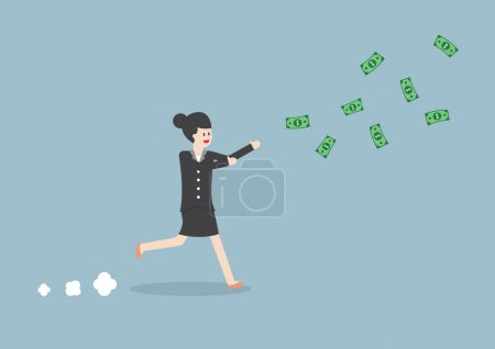 Businesswoman chasing falling dollar bills