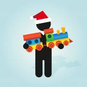 figure man with santa hat holds childrens color toy train with carriages