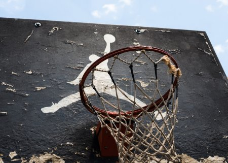 Photo for KYIV, UKRAINE -  JUNE 17, 2014: Jumpman logo by Nike painted on the black backboard of the old basketball court in Kyiv. - Royalty Free Image