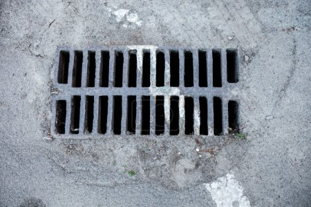 Drain grate with road marking line on it