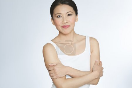 Photo for Attractive healthy Asian forty year old woman posing in casual top. - Royalty Free Image