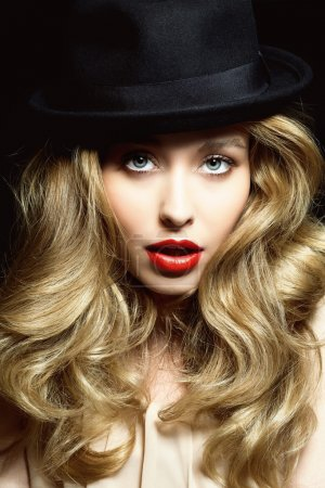 Photo for Model with gorgeous hair and red lips wearing black hat. - Royalty Free Image