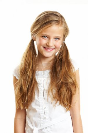 Photo for Ten year old caucasian girl with long hair posing isolated on white. - Royalty Free Image