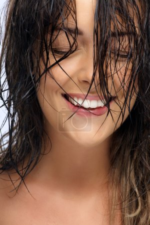 Photo for Happy beautiful natural Caucasian woman with dark wet hair. - Royalty Free Image