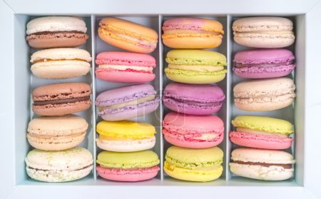 Photo for Set of different french cookies macaroons macaroons in a paper box. Top view. Coffee, chocolate, vanilla, lemon, rapsberry, strawberry, pistachio, violet, rose, orange tastes macaroons - Royalty Free Image