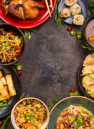 Photo for Chinese food dark background. Chinese noodles, fried rice, dumplings, peking duck, dim sum, spring rolls. Famous Chinese cuisine dishes set. Space for text. Top view. Chinese restaurant concept - Royalty Free Image