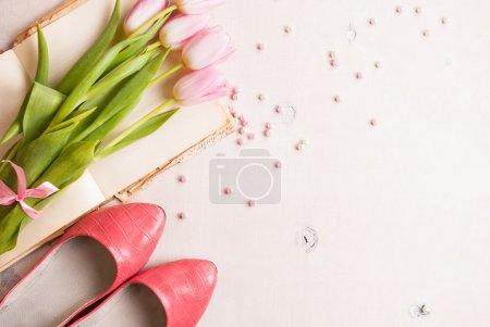 Photo for Pink tulips with ballerinas shoes over white wooden table. Spring chic background - Royalty Free Image