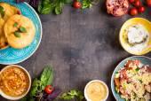 Tabulka podává s blízkovýchodní vegetariánských jídel. Homos, tahi