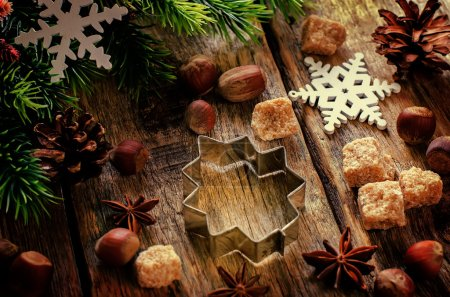Photo for Christmas baking ingredients on a dark wood background. tinting. selective focus - Royalty Free Image