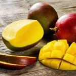 Mango on a dark wood background. tinting. selectiv...