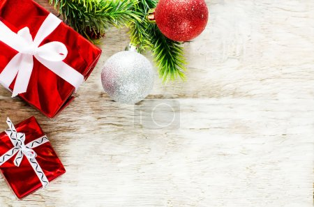 Photo for Christmas background with gifts on a light woody background. tinting. selective focus on gift - Royalty Free Image