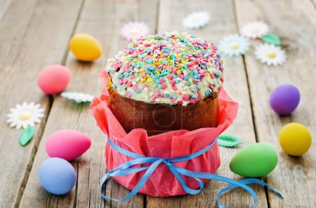 Photo for Easter cake with colorful topping on a wood background. tinting. selective focus - Royalty Free Image