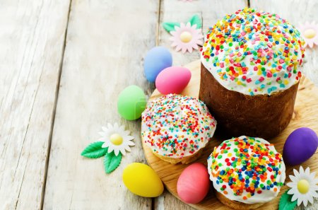Photo for Easter cakes with colorful topping on a white wood background. tinting. selective focus - Royalty Free Image