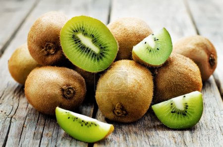 Photo for Kiwi on white wood background. tinting. selective focus - Royalty Free Image