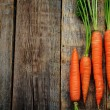 Carrot on a dark wood background. tinting. selecti...