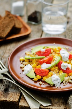 Photo for Salad with quinoa, red lentils, corn, avocado and tomato with yogurt sauce. tinting. selective focus - Royalty Free Image