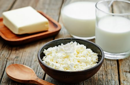 Photo for Dairy products. cottage cheese, butter, milk, cheese on a dark wood background. the toning. selective focus - Royalty Free Image