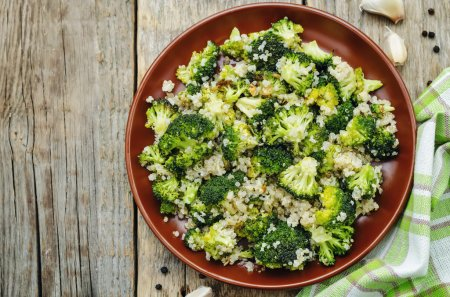 Photo for Roasted garlic broccoli quinoa salad. the toning. selective focus - Royalty Free Image