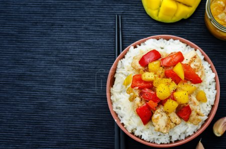 Photo for Mango chicken stir fry with rice. the toning. selective focus - Royalty Free Image